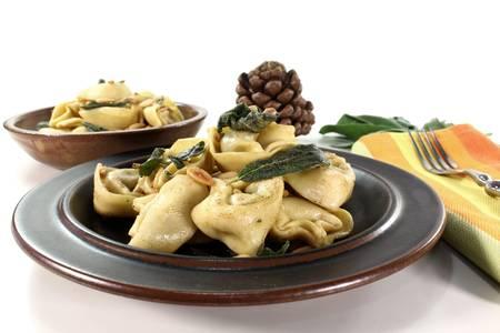 stuffed tortellini: stuffed tortellini with sage butter and pine nuts Stock Photo