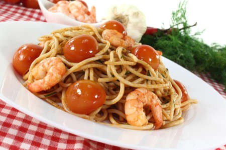 Spaghetti with tomatoes, fresh shrimp and dill photo
