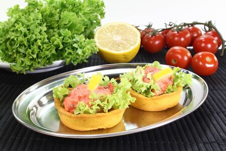 baked Maize basket with salmon salad, tomatoes and lemon Stock Photo - 12406315