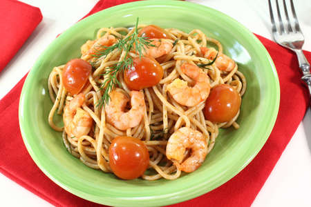freshly cooked spaghetti with tomato, shrimp and dill photo