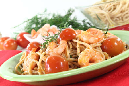 spaghetti with tomato, shrimp and fresh dill photo