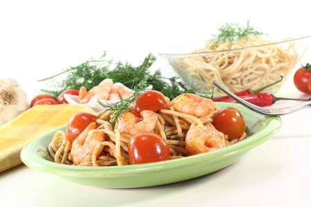 freshly cooked spaghetti with tomato, shrimp and fresh dill photo