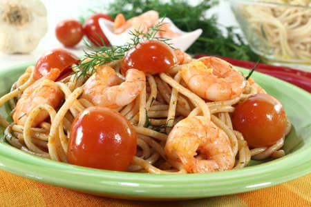 cooked spaghetti with tomato, shrimp and fresh dill photo