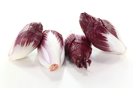endive: four red chicory on a light background