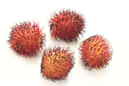 fresh red rambutan before a light background