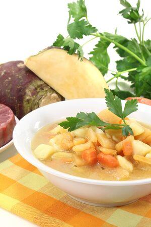 rutabaga: boiled rutabaga soup with beef, fresh carrots, potatoes and parsley Stock Photo