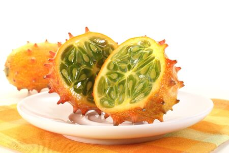 fresh sliced orange Kiwano on a white plate photo