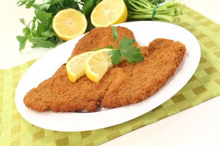 wiener: fried Wiener Schnitzel with lemon slices and parsley on a napkin Stock Photo
