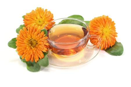fresh marigold tea with flowers and leaves on a bright background Stock Photo - 13225709