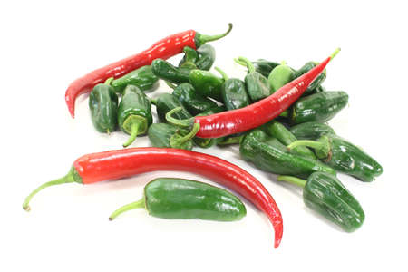 green pimientos and red chillies in a heap on light background Stock Photo - 13243788