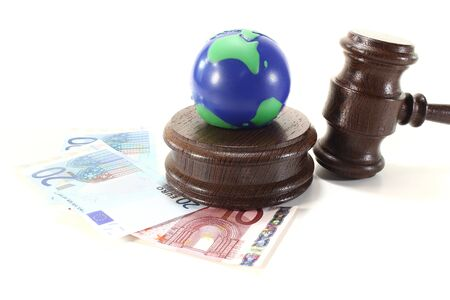brown judges Gavel with blue and green Earth on a light background Stock Photo - 13524591