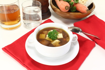 repast: fresh Beef consomme with greens, egg and parsley