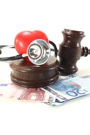 condemnation: Medical law - with judges gavel, stethoscope and money bills Stock Photo