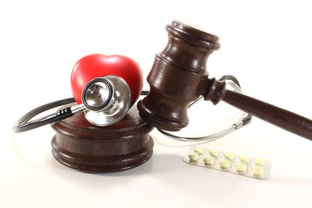 condemnation: Medical law - with judges gavel, stethoscope and tablets