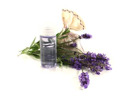 Lavender oil with Lavender bag and flowers on a bright background photo