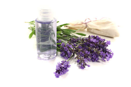 Lavender oil with Lavender bag and fresh flowers on a light background