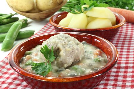 delicious fresh cooked meatballs in a white sauce with capers, garlic and parsley photo