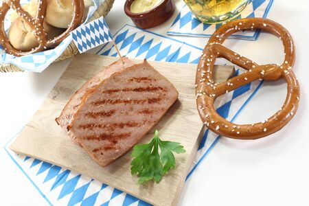 delicious Bavarian beef and pork loaf with pretzels and mustard on a light background Stock Photo - 14574711