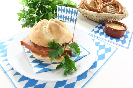 Roll with beef and pork loaf, parsley, Bavarian flag on a light background Stock Photo - 14812575