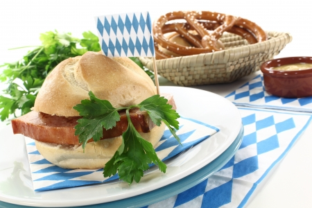 Roll with grilled beef and pork loaf, parsley, Bavarian flag, napkin on a bright background Stock Photo - 14812574
