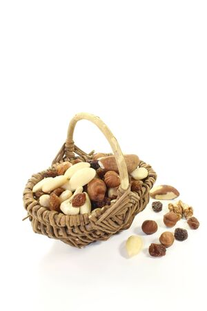 mixed nuts: Mixed nuts and raisins as a snack on a light background