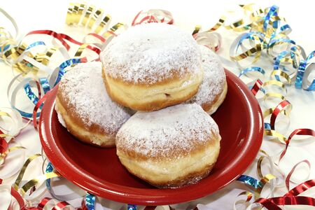 baker's: Pancakes with powdered sugar and jam on a plate with paper streamers