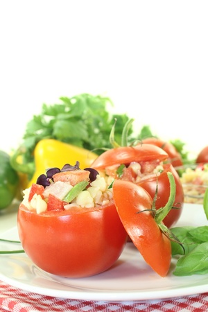 stuffed pasta salad with tomatoes and basil on a light background photo