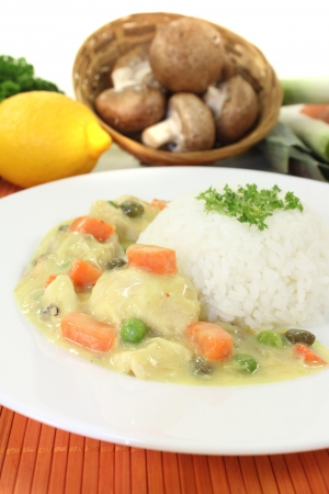 fricassee: Chicken fricassee with rice, capers and parsley on a light background Stock Photo