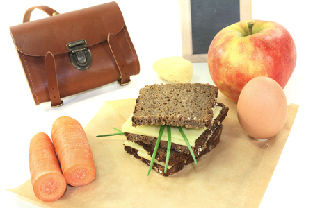 recess: sandwich eaten during recess with egg and apple on a bright background