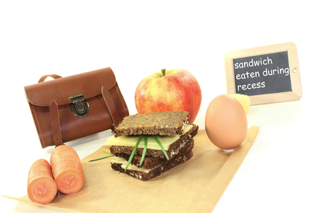 recess: sandwich eaten during recess with apple on a bright background Stock Photo