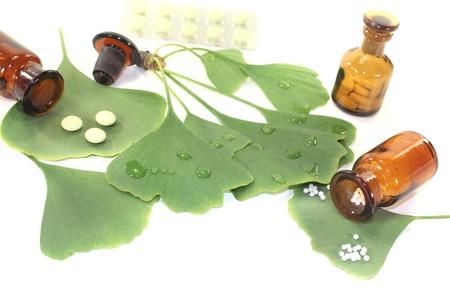 ginkgo leaf: Ginkgo leaf with pharmacist bottle on bright background