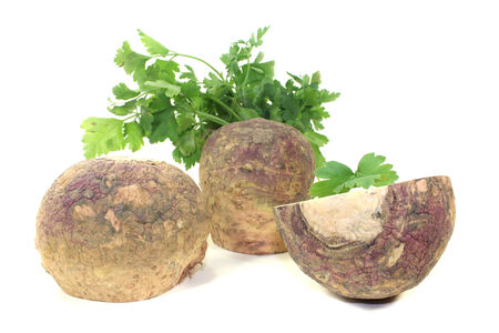 rutabaga: rutabaga with parsley on a bright background Stock Photo
