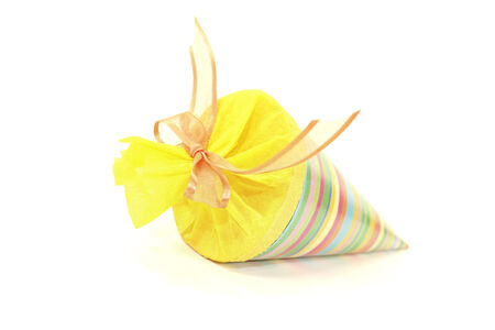 colorful school cone with ribbon on a bright background photo