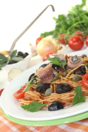 puttanesca: Spaghetti alla puttanesca with olives and anchovies Stock Photo