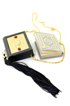 the case before: small Quran with Case before light background