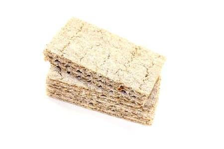 deliberately: small stack of fresh crispbread on a light background