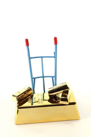 hand truck: four gold bars on a hand truck on a light background Stock Photo