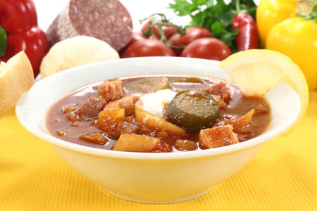 soljanka: Soljanka in a soup bowl with pickles on a light background Stock Photo
