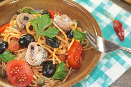 puttanesca: Spaghetti alla puttanesca with capers and anchovies