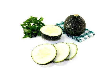 rotund: rotund raw zucchini on a napkin on a bright background Stock Photo