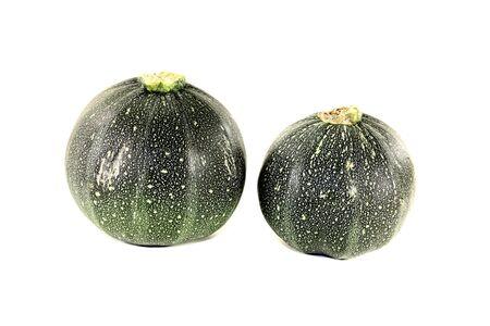 rotund: fresh rotund zucchini on a light background Stock Photo