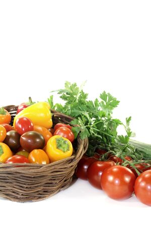 vegetable basket: Vegetable basket with mixed vegetables on a light background Stock Photo