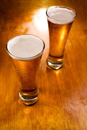 Beer glasses on wood background, selective focus   photo