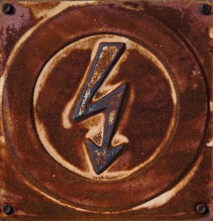 Rusty high voltage sign  photo