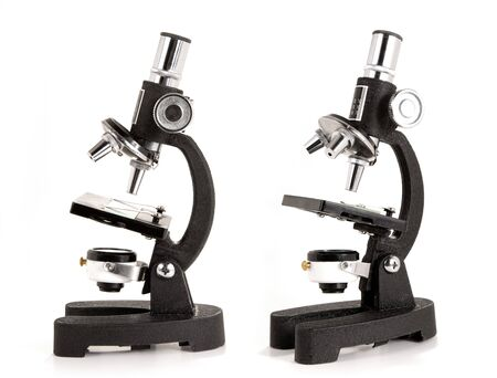 Two views of a microscope, isolated on white background Stock Photo - 4466585
