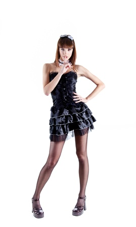 Full length shot of sexy French maid making silence sign, isolated on white background  photo