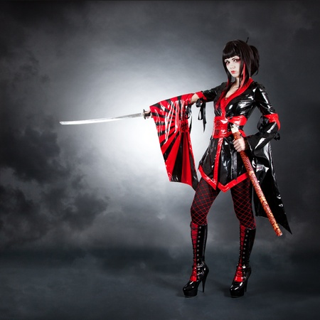 Full length shot of warrior girl wearing fetish kimono and high heeled boots  photo