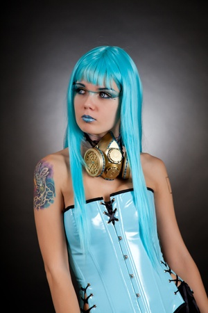Cyber gothic girl with golden gas mask wearing contact lenses and false eyelashes  photo