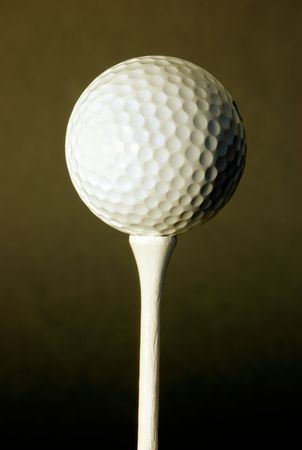 Golf ball against black background