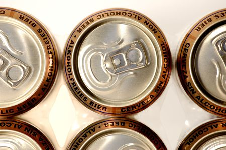 non alcoholic beer: row golden aluminum non alcoholic beer cans
